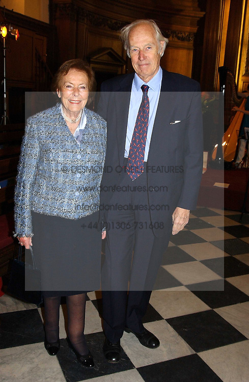 SIR GEORGE &amp; LADY MARTIN  at a carol concert in aid of the Institute of Cancer Research at the Royal Hospital Chapel, Chelsea on 2nd December 2004.<br />
