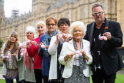 Matt O'Connor founder of Fathers4Justice joins a group of 'knitting nans' outside Parliament including 93 year-old Edna Cosnett, from New Malden who hasn't seen her great grandchild for two years. The nans are lobbying for new legislation to give separated fathers and their families greater access to their children. London, June 04 2018.