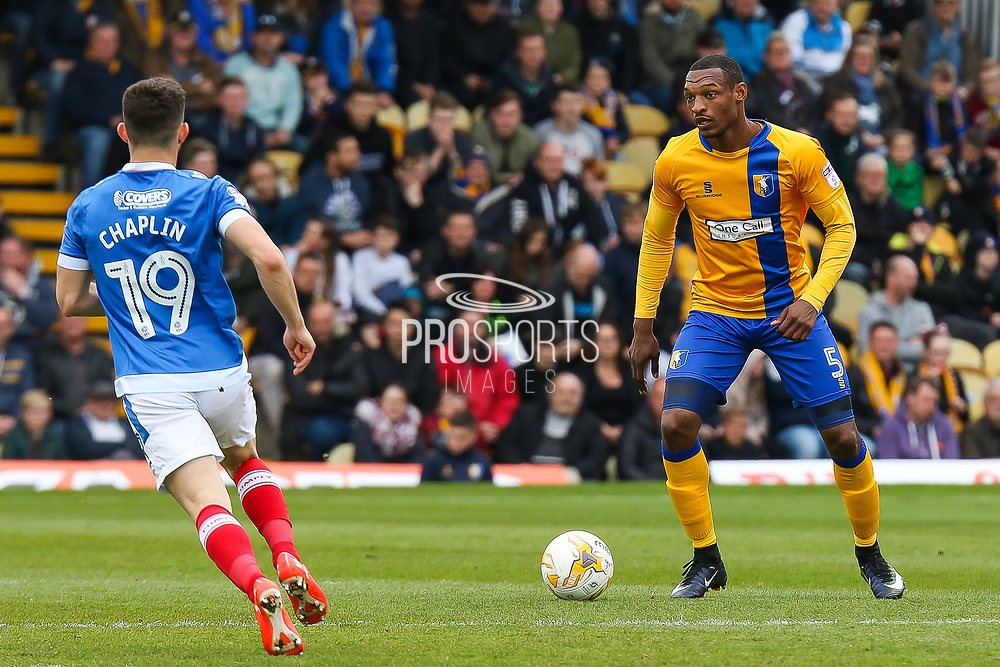 Mansfield defender Krystian Pearce on the ball during the EFL Sky Bet League 2 match between Mansfield Town and Portsmouth at the One Call Stadium, Mansfield, England on 29 April 2017. Photo by Aaron  Lupton.