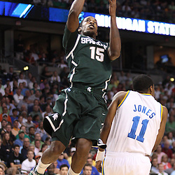 Mar 17, 2011; Tampa, FL, USA; Michigan State Spartans guard Durrell Summers (15) shoots over UCLA Bruins guard Lazeric Jones (11) during the first half of the second round of the 2011 NCAA men's basketball tournament at the St. Pete Times Forum.  Mandatory Credit: Derick E. Hingle