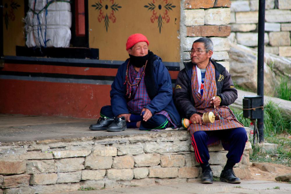 Asia, Bhutan, Thimpu. Bhutanese locals at the Memorial Chorten.