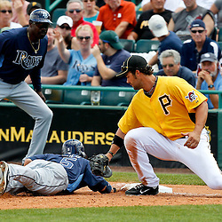 March 22, 2012; Bradenton, FL, USA; Tampa Bay Rays left fielder Sam Fuld (5) dives back to the bag before Pittsburgh Pirates first baseman Garrett Jones (46) can make a tag during the top of the fifth inning of a spring training game at McKechnie Field. Mandatory Credit: Derick E. Hingle-US PRESSWIRE