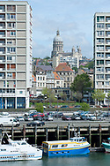 Basilica of Notre-Dame, framed by 1950s apartment blocks built by architect Pierre Vivien during the post-WW2 reconstruction of the waterfront. Boulogne-sur-Mer, Pas-de-Calais, France © Rudolf Abraham