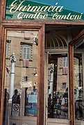Italy, Siena, the Palio: daily life in the contradas, waiting for the final race. the ancient  Pharmacy in Piazza Posterla, so called Quattrlo Cantoni