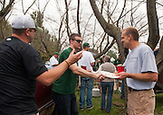 Jegg Grinstead, left, Matt Weiler, center, and Lincoln Royse, right, converse during the Homecoming 2013 tailgate event. Photo by Elizabeth Held