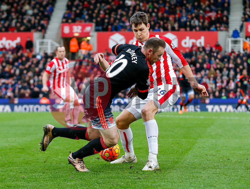 Wayne Rooney of Manchester United is tackled by Philipp Wollscheid of Stoke City - Mandatory byline: Rogan Thomson/JMP - 26/12/2015 - FOOTBALL - Britannia Stadium - Stoke, England - Stoke City v Manchester United - Barclays Premier League - Boxing Day Fixture.