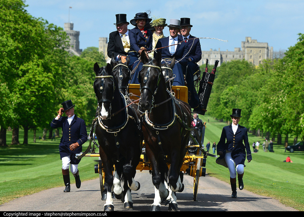 © Licensed to London News Pictures. 10/05/2013. Windsor, UK  HRH Queen Elizabeth II watches horses in the show. The Royal Windsor Horse Show, set in the grounds of Windsor Castle. Established in 1943, this year will see the Show celebrate its 70th anniversary. Photo credit : Stephen Simpson/LNP