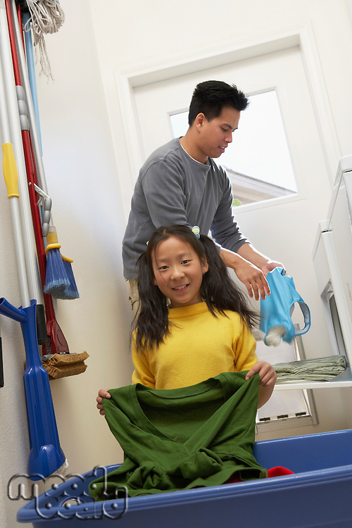 Man and Daughter Doing Laundry