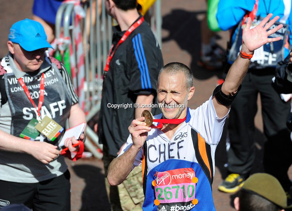 Michel Roux Junior at the finish<br /> The Virgin Money London Marathon 2014<br /> 13 April 2014<br /> Photo: Javier Garcia/Virgin Money London Marathon<br /> media@london-marathon.co.uk