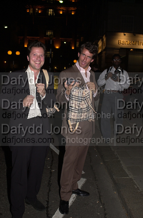 Tim Jeffreys with party favour leaving. Burberry Bond St. Launch party. 21-23 New Bond St. London. In Support of the Sargent Cancer Care for Children. 7/9/00 © Copyright Photograph by Dafydd Jones 66 Stockwell Park Rd. London SW9 0DA Tel 020 7733 0108 www.dafjones.com