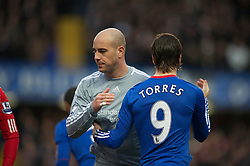 LONDON, ENGLAND - Sunday, February 6, 2011: Liverpool's Jamie Carragher and Chelsea's Fernando Torres during the Premiership match at Stamford Bridge. (Photo by David Rawcliffe/Propaganda)