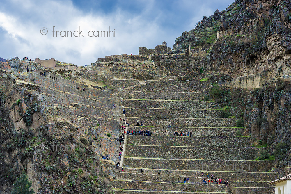 Ollantaytambo, Peru - July 16, 2013: tourists at Ollantaytambo, Incas ruins in the peruvian Andes at Cuzco Peru on July 16 2013