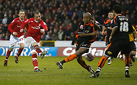 Photo: Richard Lane/Richard Lane Photography. Nottingham Forest v Blackpool. Coca Cola Championship. 13/12/2008. Joe Garner (L) shoots as Alex Baptiste (C) closes down