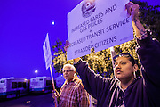 12 MARCH 2012 - PHOENIX, AZ:      LISA ESTRADA, a striking bus driver, stands in front of the Veolia Transportation bus barns in Phoenix, AZ, Monday. Nearly 900 bus drivers from Amalgamated Transit Union Local 1433  are on strike against Veolia Transportation which is contracted to provide bus service for Valley Metro, the bus service that spans the Phoenix metropolitan area. The routes affected by the strike are in Phoenix and the suburbs of Tempe and Glendale. According to the union, the strike was called because of Veolia's conduct during negotiations, which have lasted more than two years. The union has filed Unfair Labor Practices charges against Veolia with The National Labor Relations Board and the NLRB is taking Veolia before an Administrative Law Judge on April 3, 2012 to answer the charges.   PHOTO BY JACK KURTZ