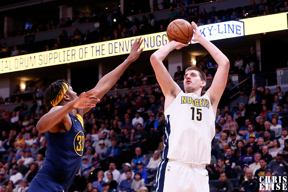 03 April 2018: Denver Nuggets center Nikola Jokic (15) takes a jump shot over Indiana Pacers center Myles Turner (33) during the Denver Nuggets 107-104 victory over the Indiana Pacers, at the Pepsi Center, Denver, Colorado, USA.