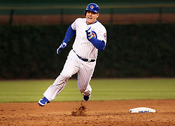 June 4, 2017 - Chicago, IL, USA - Chicago Cubs first baseman Anthony Rizzo (44) tries to stretch his hit to a triple but gets tagged at third base during the fifth inning against the St. Louis Cardinals on Sunday, June 4, 2017 at Wrigley Field in Chicago, Ill. (Credit Image: © Nuccio Dinuzzo/TNS via ZUMA Wire)