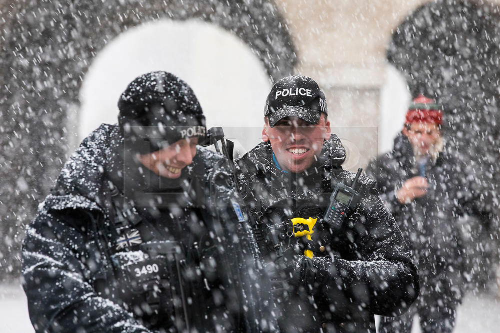 © Licensed to London News Pictures. 27/02/2018. London, UK. Two policemen stand guard on Horse Guards Parade in central London as heavy snow falls. Severe cold, blizzards and heavy snow are expected for the rest of the week as the 'Beast from the East' brings freezing Siberian air to the UK. Photo credit: Rob Pinney/LNP