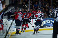 KELOWNA, CANADA - NOVEMBER 17: Dylan Cozens #24 fist bumps Giorgio Estephan #9 of the Lethbridge Hurricanes on his second goal of the second period against the Kelowna Rockets on November 17, 2017 at Prospera Place in Kelowna, British Columbia, Canada.  (Photo by Marissa Baecker/Shoot the Breeze)  *** Local Caption ***