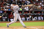 May 15, 2016; Phoenix, AZ, USA; San Francisco Giants catcher Trevor Brown (14) hits a solo home run in the third inning Arizona Diamondbacks at Chase Field. Mandatory Credit: Jennifer Stewart-USA TODAY Sports