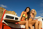 Two Young Women Sitting in Back of Truck