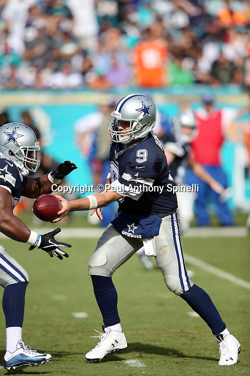 Dallas Cowboys quarterback Tony Romo (9) hands off the ball on a running play during the 2015 week 11 regular season NFL football game against the Miami Dolphins on Sunday, Nov. 22, 2015 in Miami Gardens, Fla. The Cowboys won the game 24-14. (©Paul Anthony Spinelli)