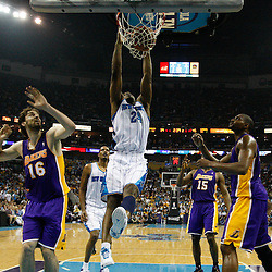 April 24, 2011; New Orleans, LA, USA; New Orleans Hornets power forward Carl Landry (24) dunks over Los Angeles Lakers power forward Pau Gasol (16) during the first half in game four of the first round of the 2011 NBA playoffs at the New Orleans Arena. The Hornets defeated the Lakers 93-88.   Mandatory Credit: Derick E. Hingle