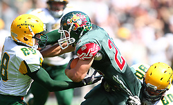 10.07.2011, Tivoli Stadion, Innsbruck, AUT, American Football WM 2011, Group A, Mexico (MEX) vs Australia (AUS), im Bild Reyes José (Mexico, #22, RB) gets stopped by Bryn  Nightingale (Australia, #88, DB) and Bradley Bennett (Australia, #80, LB)  // during the American Football World Championship 2011 Group A game, Mexico vs Australia, at Tivoli Stadion, Innsbruck, 2011-07-10, EXPA Pictures © 2011, PhotoCredit: EXPA/ T. Haumer