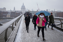 © Licensed to London News Pictures. 02/03/2018. London, UK. People brave strong wind and snow on Millennium Bridge in London as the 'Beast from the East' and Storm Emma continue to bring extreme cold, ice and heavy snow to the UK. Photo credit: Rob Pinney/LNP