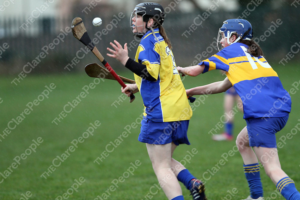 Maire McGrath Sixmilebridge about to gather possession ahead of Newmarket's Kate O'Neill during the Clare People U18A Camogie Final.<br /> Photograph by Flann Howard