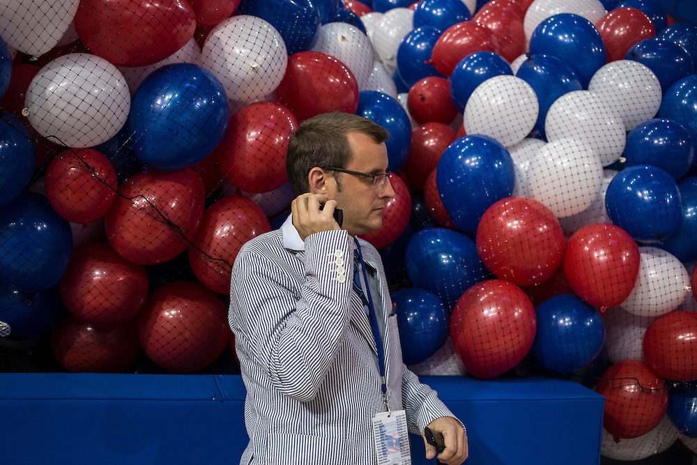 A man talks on the phone at the Republican National Convention on Friday, August 24, 2012 in Tampa, FL.