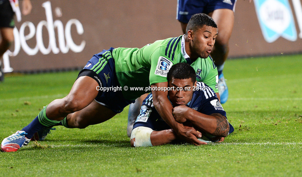 Charles Piutau dives over for a try. Blues v Highlanders. Investec Super Rugby Season. Eden Park, Auckland, New Zealand. Saturday 29 March 2014. Photo: Andrew Cornaga/Photosport.co.nz