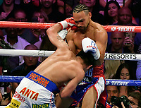 LAS VEGAS, NEVADA - JULY 20. <br /> Manny Pacquiao (L) hits Keith Thurman during their WBA welterweight title fight at MGM Grand Garden Arena on July 20, 2019 in Las Vegas, Nevada. Pacquiao went 12 rounds and took the win by a split decision.  (MB Media)