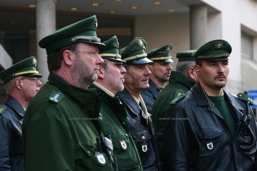 "A group of high ranked police men are seen beside a anti war demonstration in Munich. Serveral thousend people demonstrate in Munich against the 45. ""Munich Security Conference"". They demanded the withdrawal of the troops from Afghanistan and expressed their displeasure about the NATO and its policy."
