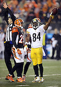 Cincinnati Bengals cornerback Leon Hall (29) looks on as Pittsburgh Steelers wide receiver Antonio Brown (84) drops the ball in celebration after catching a second quarter pass good for a gain of 17 yards and a first down negated by an illegal formation penalty called on the Steelers during the NFL AFC Wild Card playoff football game against the Cincinnati Bengals on Saturday, Jan. 9, 2016 in Cincinnati. The Steelers won the game 18-16. (©Paul Anthony Spinelli)