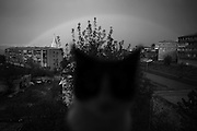 "A cat on window board while rain makes a rainbow visible above Shushi. This image is part of the photoproject ""The Twentieth Spring"", a portrait of caucasian town Shushi 20 years after its so called ""Liberation"" by armenian fighters. In its more than two centuries old history Shushi was ruled by different powers like armeniens, persians, russian or aseris. In 1991 a fierce battle for Karabakhs independence from Azerbaijan began. During the breakdown of Sowjet Union armenians didn´t want to stay within the Republic of Azerbaijan anymore. 1992 armenians manage to takeover ""ancient armenian Shushi"" and pushed out remained aseris forces which had operate a rocket base there. Since then Shushi became an ""armenian town"" again. Today, 20 yeras after statement of Karabakhs independence Shushi tries to find it´s opportunities for it´s future. The less populated town is still affected by devastation and ruins by it´s violent history. Life is mostly a daily struggle for the inhabitants to get expenses covered, caused by a lack of jobs and almost no perspective for a sustainable economic development. Shushi depends on donations by diaspora armenians. On the other hand those donations have made it possible to rebuild a cultural centre, recover new asphalt roads and other infrastructure. 20 years after Shushis fall into armenian hands Babies get born and people won´t never be under aseris rule again. The bloody early 1990´s civil war has moved into the trenches of the frontline 20 kilometer away from Shushi where it stuck since 1994. The karabakh conflict is still not solved and could turn to an open war every day. Nonetheless life goes on on the south caucasian rocky tip above mountainious region of Karabakh where Shushi enthrones ever since centuries."