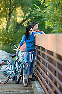 Couple rides cruiser bicylces on local bike path in Whitefish Montana model released
