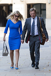 © Licensed to London News Pictures. 15/08/2017. LONDON, UK.  CRAIG MACKINLAY, Conservative MP for South Thanet<br /> with his wife, Kati arrive at Southwark Crown Court for a Plea and Trial Preparation Hearing (PTPH). CRAIG MACKINLAY, Conservative MP for South Thanet, MARION LITTLE, Craig Mackinlay's campaign director and NATHAN GRAY, Craig Mackinlay's election agent have each been charged with offences under the Representation of the People Act 1983.  Photo credit: Vickie Flores/LNP