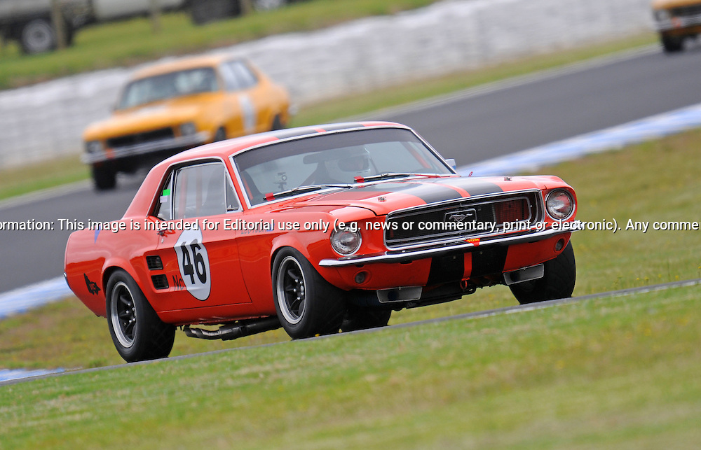 Leo Tobin - Group Nc - Ford Mustang.Historic Motorsport Racing - Phillip Island Classic.18th March 2011.Phillip Island Racetrack, Phillip Island, Victoria.(C) Joel Strickland Photographics.Use information: This image is intended for Editorial use only (e.g. news or commentary, print or electronic). Any commercial or promotional use requires additional clearance.