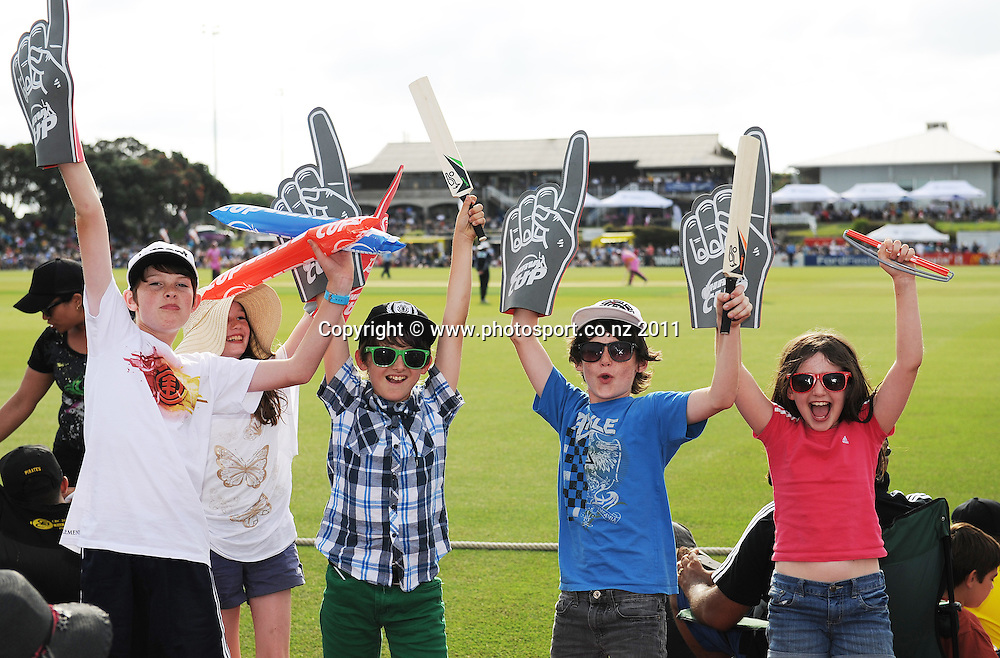 Cricket fans during the HRV Twenty20 Cricket match between the Auckland Aces and Northern Knights at Colin Maiden Oval in Auckland on Monday 26 December 2011. Photo: Andrew Cornaga/Photosport.co.nz