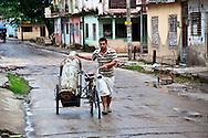 Bicitaxi hauling propane in Holguin,Cuba.