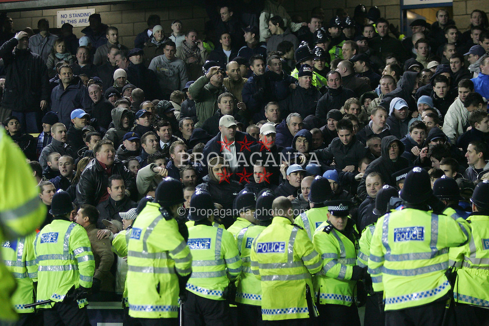 LONDON, ENGLAND - SATURDAY, JANUARY 7th, 2006: Millwall's fans fight with police during the FA Cup 3rd Round match at the New Den. (Pic by Chris Brunskill/Propaganda)