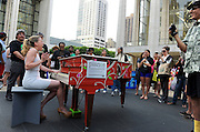 Marissa Pontecorvo, of Staten Island, NY, a former American Idol contestant, performs on one of the 88 Sing for Hope Pianos, supported by Chobani, Inc., at Lincoln Center, Sunday, June 16, 2013, in New York, during the finale concert of Sing for Hope Pianos.  (Photo by Diane Bondareff/Invision for Sing for Hope/AP Images)