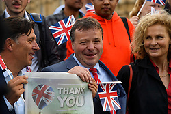 © Licensed to London News Pictures. 24/06/2016. London, UK. UKIP donor ARRON BANKS and ANDY WIGMORE celebrating in Westminster on the day that the UK voted to leave the EU in a referendum. Photo credit: Ben Cawthra/LNP