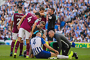 Jack Cork (Burnley) taking a closer look at the medical team working on Shane Duffy (Brighton) head wound during the Premier League match between Brighton and Hove Albion and Burnley at the American Express Community Stadium, Brighton and Hove, England on 14 September 2019.