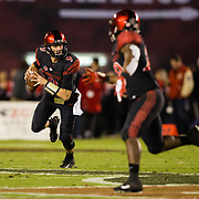 10 November 2018: San Diego State Aztecs quarterback Ryan Agnew (9) rolls out of the pocket on a quarterback keeper for a first down in the second quarter. The Aztecs lost 27-24 to UNLV Saturday night at SDCCU Stadium falling a game behind Fresno State in the conference standings.