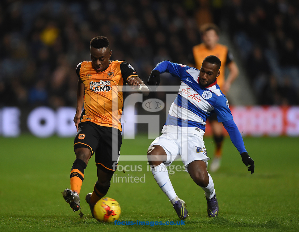 Hull City's Moses Odubajo (left) and Queens Park Rangers' David Hoilett battle during the Sky Bet Championship match at the Loftus Road Stadium, London<br /> Picture by Daniel Hambury/Focus Images Ltd +44 7813 022858<br /> 01/01/2016
