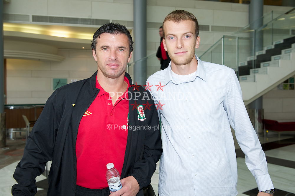 SOFIA, BULGARIA - Wednesday, October 12, 2011: Wales' manager Gary Speed MBE with Bulgarian FA's Teodor Stoynov after the UEFA Euro 2012 Qualifying Group G match. (Pic by David Rawcliffe/Propaganda)