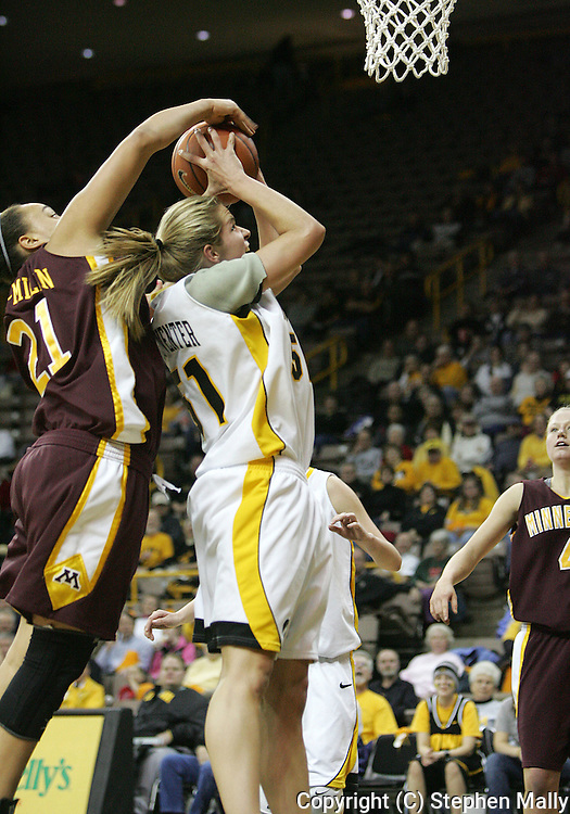 25 JANUARY 2007: Minnesota forward/center Ashley Ellis-Milan (21) blocks the shot of Iowa forward Krista VandeVenter (51) in Iowa's 80-78 overtime loss to Minnesota at Carver-Hawkeye Arena in Iowa City, Iowa on January 25, 2007.
