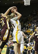 25 JANUARY 2007: Minnesota forward/center Ashley Ellis-Milan (21) blocks the shot of Iowa forward Krista VandeVenter (51) in Iowa's 80-78 overtime loss to Minnesota at Carver-Hawkeye Arena in Iowa City, Iowa on January 25, 2007.