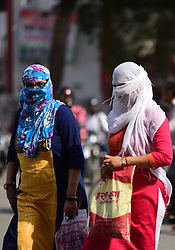 April 17, 2018 - Allahabad, Uttar Pradesh, India - Girls cover their face with clothe to being safe with scorching heat on a hot day in Allahabad. (Credit Image: © Prabhat Kumar Verma/Pacific Press via ZUMA Wire)